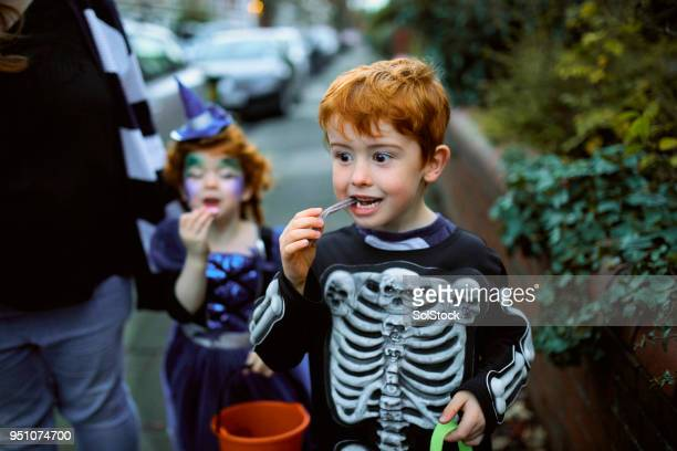 eating halloween candy - happy halloween stock photos and pictures