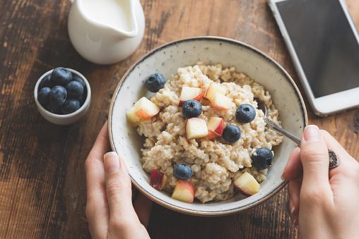 Eating healthy breakfast. Oatmeal porridge in bowl - gettyimageskorea