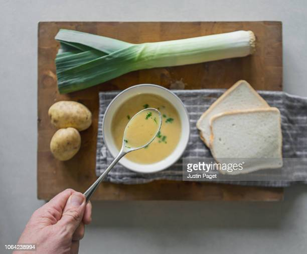 eating homemade leek and potato soup - leek stock pictures, royalty-free photos & images
