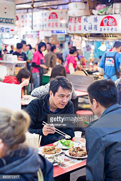 Eating in Shilin market