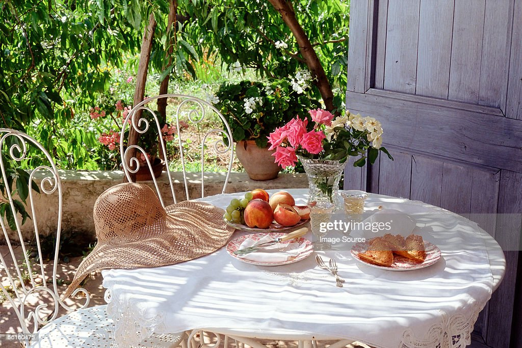 Eating in the garden under a peach tree : Stock Photo