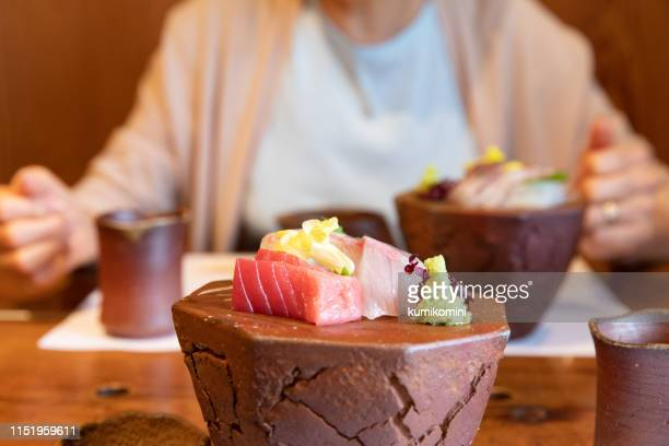 eating japanese food - sashimi stock photos and pictures