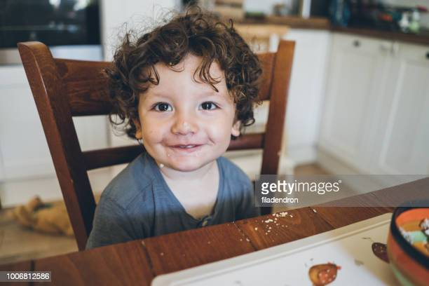 eating lunch and making mess - brown hair stock pictures, royalty-free photos & images