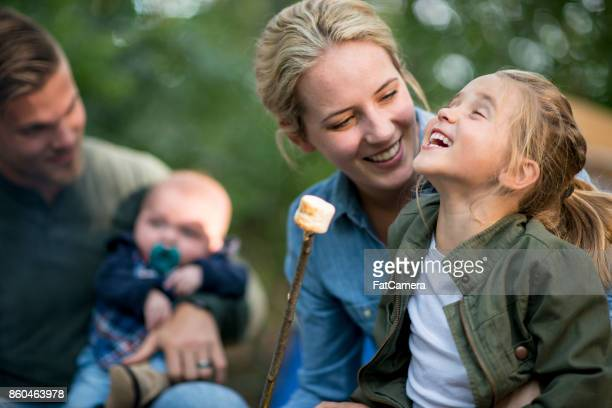 eating marshmallows - camping stock photos and pictures