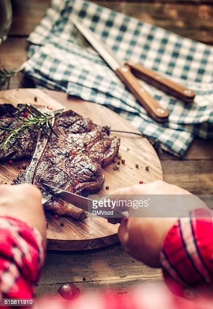 Eating Medium Roasted T-Bone Steak
