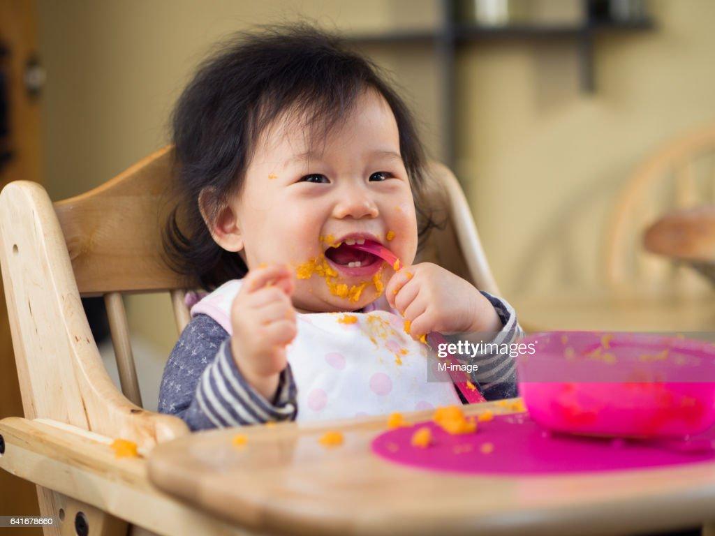 eating mess baby girl : Stock Photo