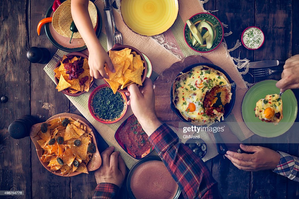 Eating Mexican Eggs and Tortilla Chips with Salsa and Jalapenos : Stock Photo