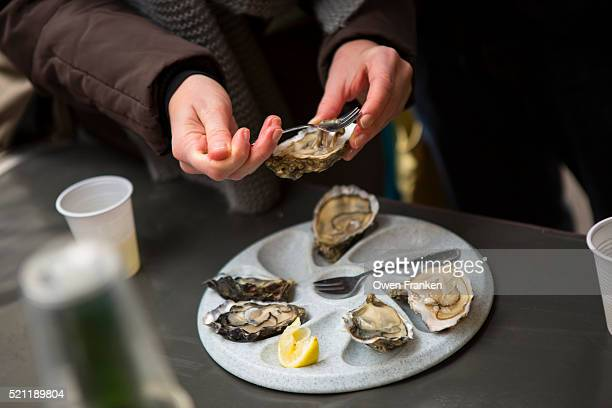 Eating Oysters On The Half-Shell At Sunday Open Air Produce Market At La Bastille, Paris