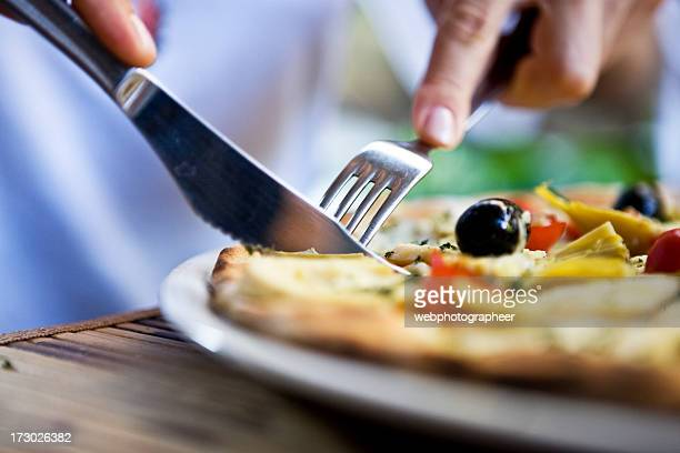 eating piza - table knife stock pictures, royalty-free photos & images