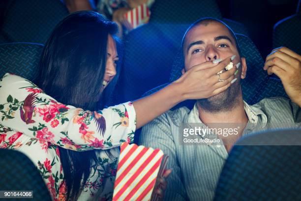 Eating popcorn at a cinema