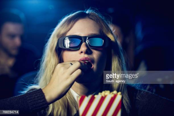 Eating popcorn in movies