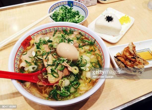 Eating ramen and dumplings in Japanese restaurant