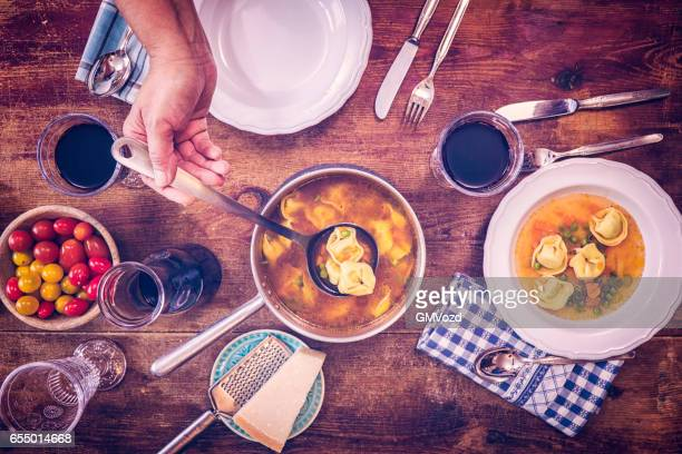 Eating Ravioli with Tomato and Tortellini Soup