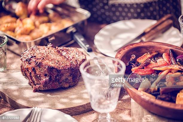 Eating Roast Beef with Potatoes and Root Vegetables