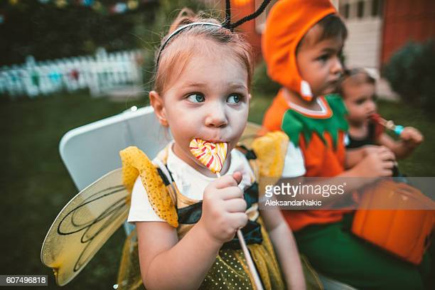 eating some halloween candy - halloween candy stock photos and pictures