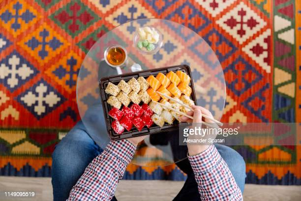 eating sushi at home, directly above personal perspective view - ornate stock pictures, royalty-free photos & images