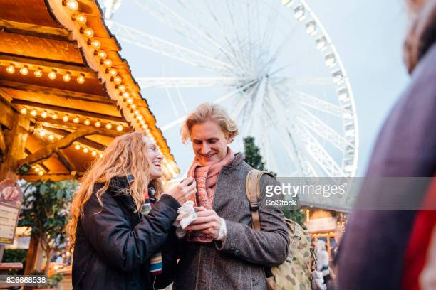 eating sweets at winter market - hyde park london stock pictures, royalty-free photos & images