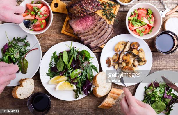 eating tasty food. favorite meal - table stock pictures, royalty-free photos & images