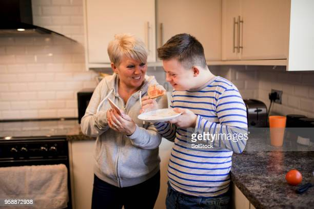 eating toast in the kitchen - down syndrome stock pictures, royalty-free photos & images