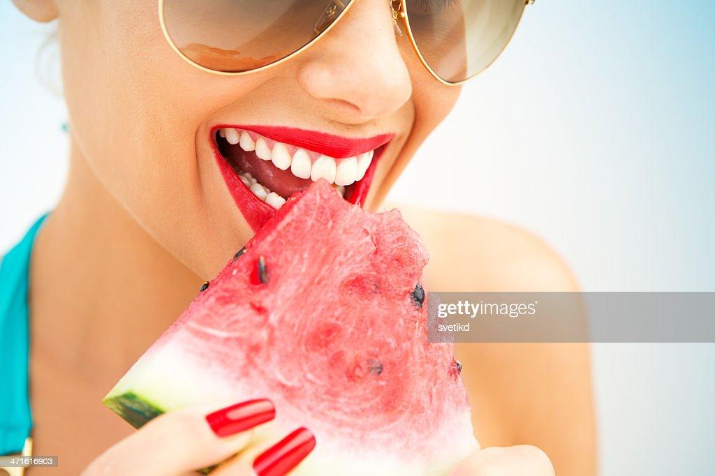 Eating watermelon. : Stock Photo
