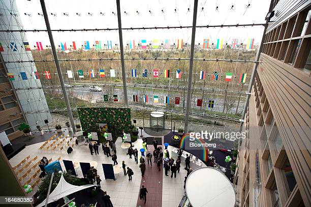EBay employees stand in the glass fronted entrance area of EBay Inc's European headquarters at Blanchardstown in Dublin Ireland on Friday March 15...