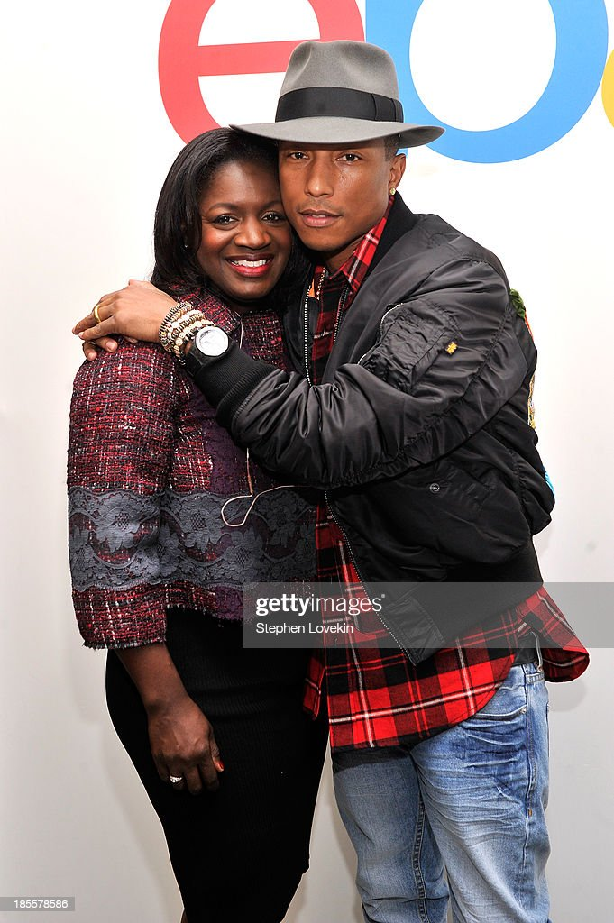 eBay's chief marketing officer Richelle Parham and Pharrell Williams attend eBays launch of new features during its Future of Shopping event at Industria Studios on October 22, 2013 in New York City.