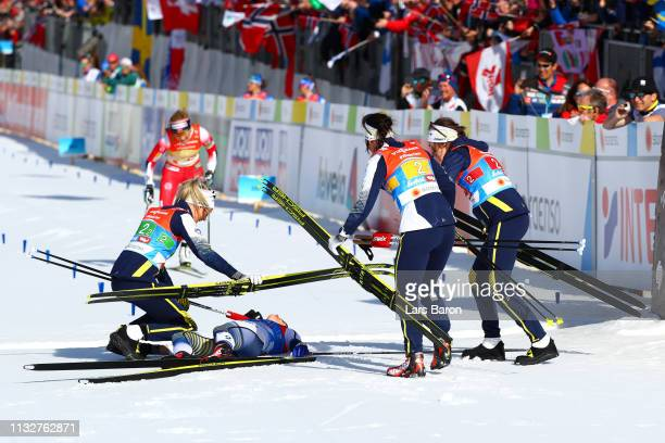 Ebba Andersson Frida Karlsson Charlotte Kalla and Stina Nilsson of Sweden celebrate victory during the Women's 4x5km Cross Country Relay at the FIS...