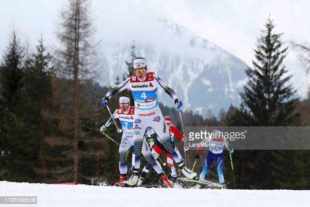 Ebba Andersson of Sweden and Charlotte Kalla of Sweden competes in the Women's Cross Country 30k race during the FIS Nordic World Ski Championships...