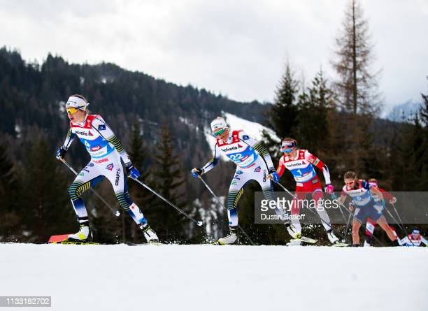 Ebba Andersson of Sweden and Frida Karlsson of Sweden compete in the Women's 30km Cross Country mass start during the FIS Nordic World Ski...