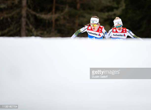 Ebba Andersson of Sweden and Frida Karlsson of Sweden competes in the Women's 30km Cross Country mass start during the FIS Nordic World Ski...