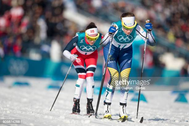 Ebba Andersson of Sweden and Heidi Weng of Norway in action during the CrossCountry Skiing Ladies' 30km Mass Start Classic at the Alpensia...