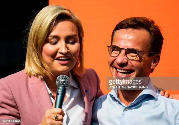 Ebba Busch Thor leader of the Christian Democrats Party in Sweden shares a laugh with Ulf Kristersson leader of the Moderate Party in Sweden during a...