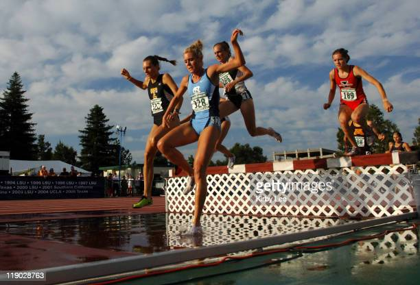 Ebba Stenback of Toledo and Cassie King of North Carolina negotiate the water jump in the women's steeplechase in the NCAA Track Field Championships...