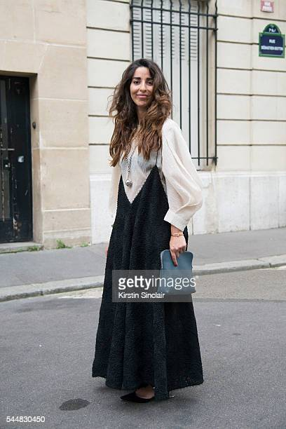 Ebba wears a Christian Dior dress and blouse Proenza Schouler shoes and Phillip Lim bag on day 1 of Paris Haute Couture Fashion Week Autumn/Winter...