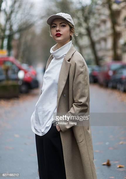 60771243a53 Ebba Zingmark wearing a beige bixtol wool coat a white Weekday turtleneck  jumper black wide leg