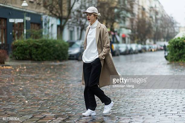 Ebba Zingmark wearing a beige bixtol wool coat a white Weekday turtleneck  jumper black wide leg 31c6de99c6