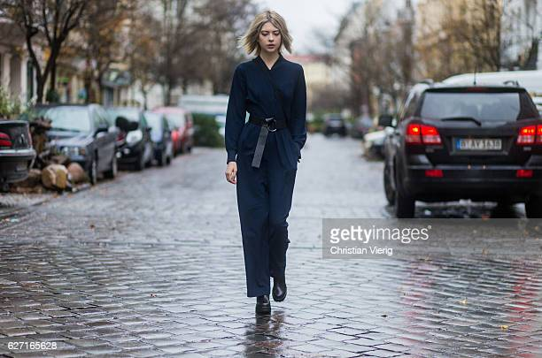 Ebba Zingmark wearing a navy jumpsuit from Lacoste black Vagabond ankle boots a black Naked belt a vintage bag on December 2 2016 in Berlin Germany