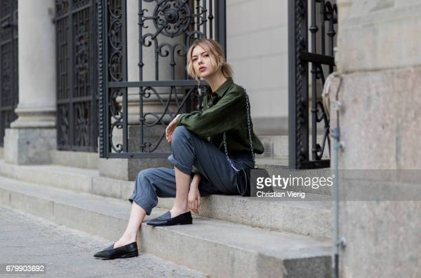 Ebba Zingmark wearing grey high waisted pants Urban Outfitters wearing an  olive green button shirt Uniqlo 648e4c30cf