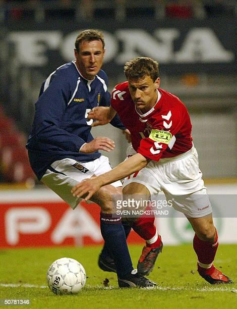 Ebbe Sand of Denmark breaks away from Malcolm Mackay of Scotland in the friendly football match in Copenhagen 28 April 2004 Denmark has qualified for...