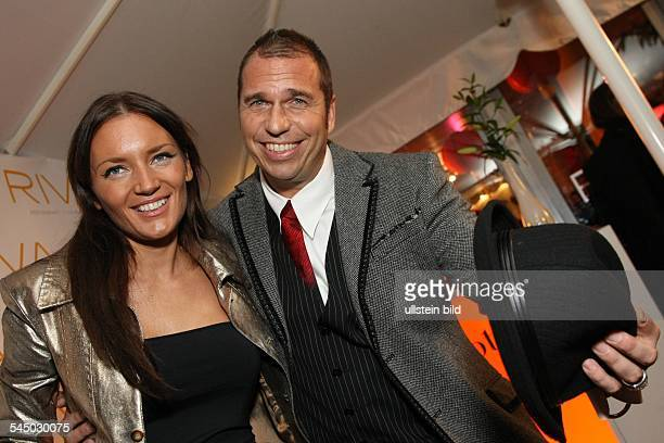 Ebel Kai Journalist Sports Presenter Germany with partner Mila Wiegand during the opening of her vernissage 'China' at the restaurant Riva in...