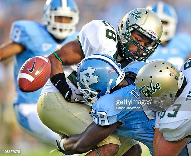 Ebele Okakpu of the North Carolina Tar Heels forces a fumble by Ryan Woolfork of the William and Mary Tribe at Kenan Stadium on October 30 2010 in...