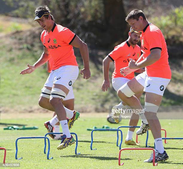 Eben Etzebeth and Bakkies Botha warm up during the South African Springboks training session held at St Peter's College on October 1 2014 in...