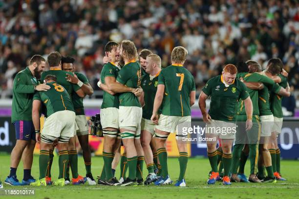 Eben Etzebeth and RG Snyman of South Africa celebrate victory over England with their team mates following the Rugby World Cup 2019 Final between...