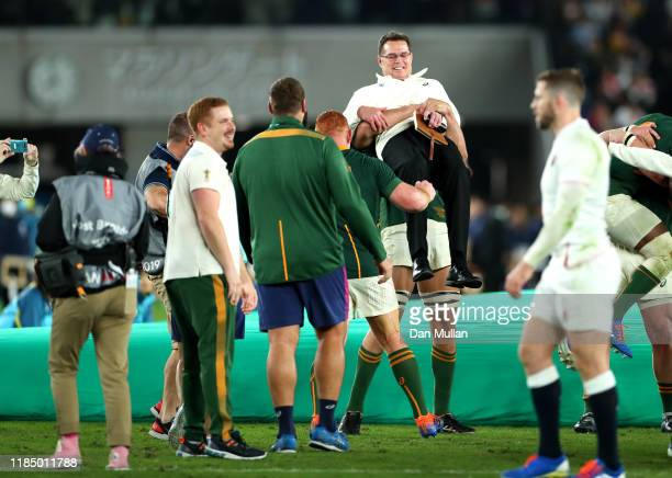 Eben Etzebeth of South Africa celebrates victory over England by lifting Rassie Erasmus Head Coach of South Africa following the Rugby World Cup 2019...