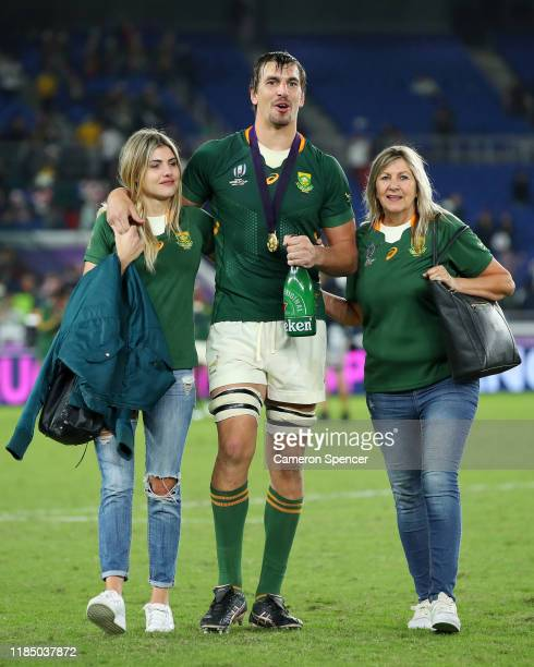 Eben Etzebeth of South Africa celebrates victory with his girlfriend Ashley Rothman and his mother after the Rugby World Cup 2019 Final between...