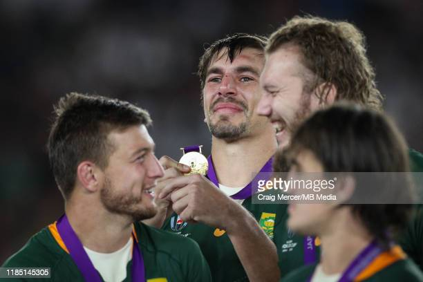 Eben Etzebeth of South Africa celebrates with his winners medal after the Rugby World Cup 2019 Final between England and South Africa at...