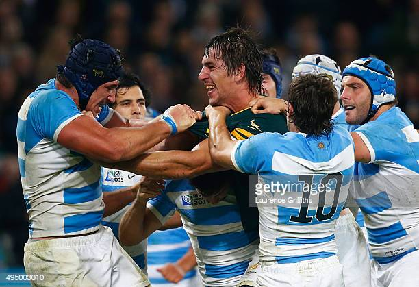 Eben Etzebeth of South Africa clashes with Tomas Lavanini and Nicolas Sanchez of Argentina during the 2015 Rugby World Cup Bronze Final match between...