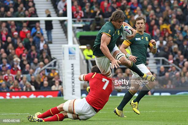 Eben Etzebeth of South Africa is tackled by Sam Warburton of Wales during the 2015 Rugby World Cup QuarterFinal match between South Africa and Wales...