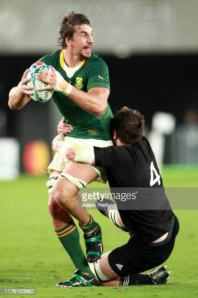 Eben Etzebeth of South Africa is tackled by Samuel Whitelock of New Zealand during the Rugby World Cup 2019 Group B game between New Zealand and...