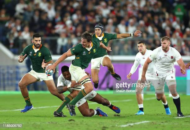 Eben Etzebeth of South Africa passes the ball to Damian de Allende of South Africa during the Rugby World Cup 2019 Final between England and South...